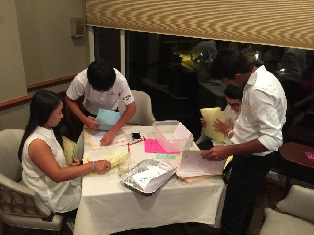 Jasmine, Shiso, Santiago and Saptak tally the results of the silent auction