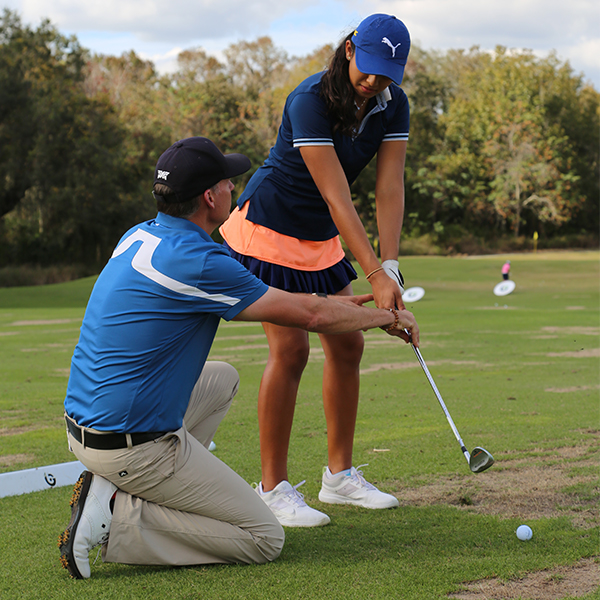 junior golf academy student training kevin smeltz