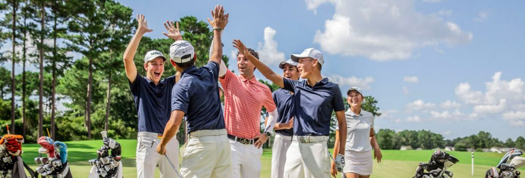youth golfers in blue, coral, and white golf shirts and white golf pants and skirt