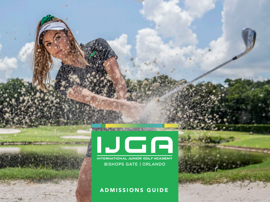 youth female golfer with club on a course clubbing sand into the camera with a green IJGA sign